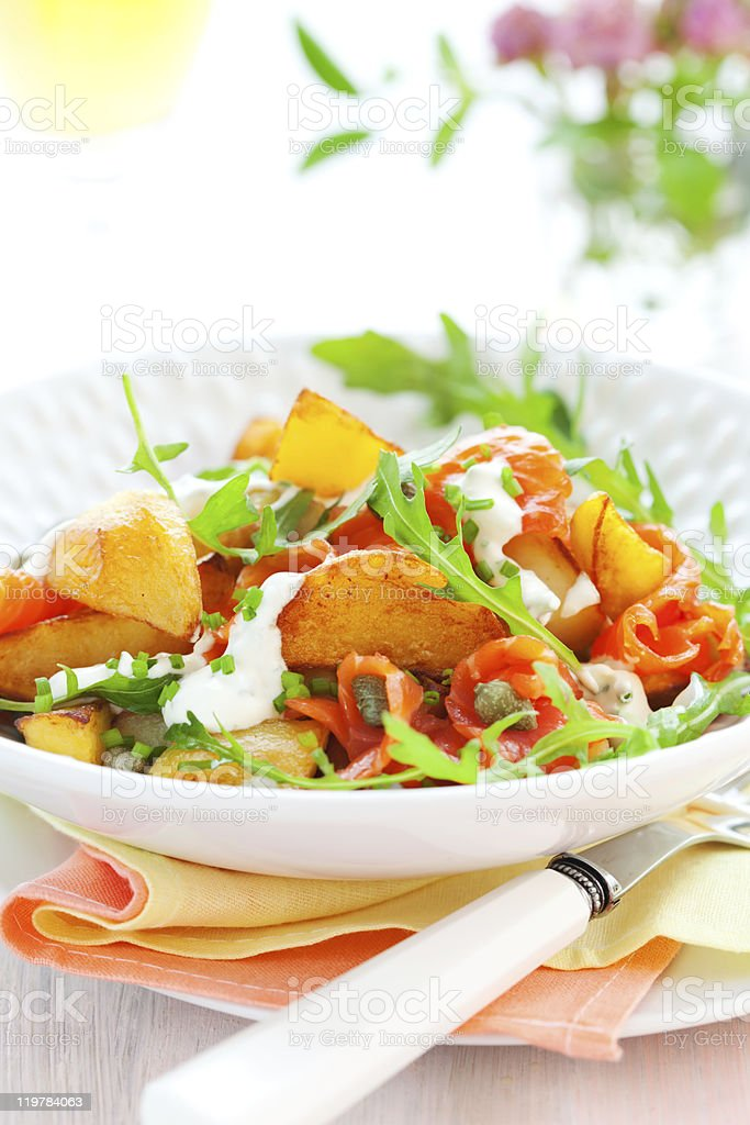 Potato salad with smoked salmon royalty-free stock photo