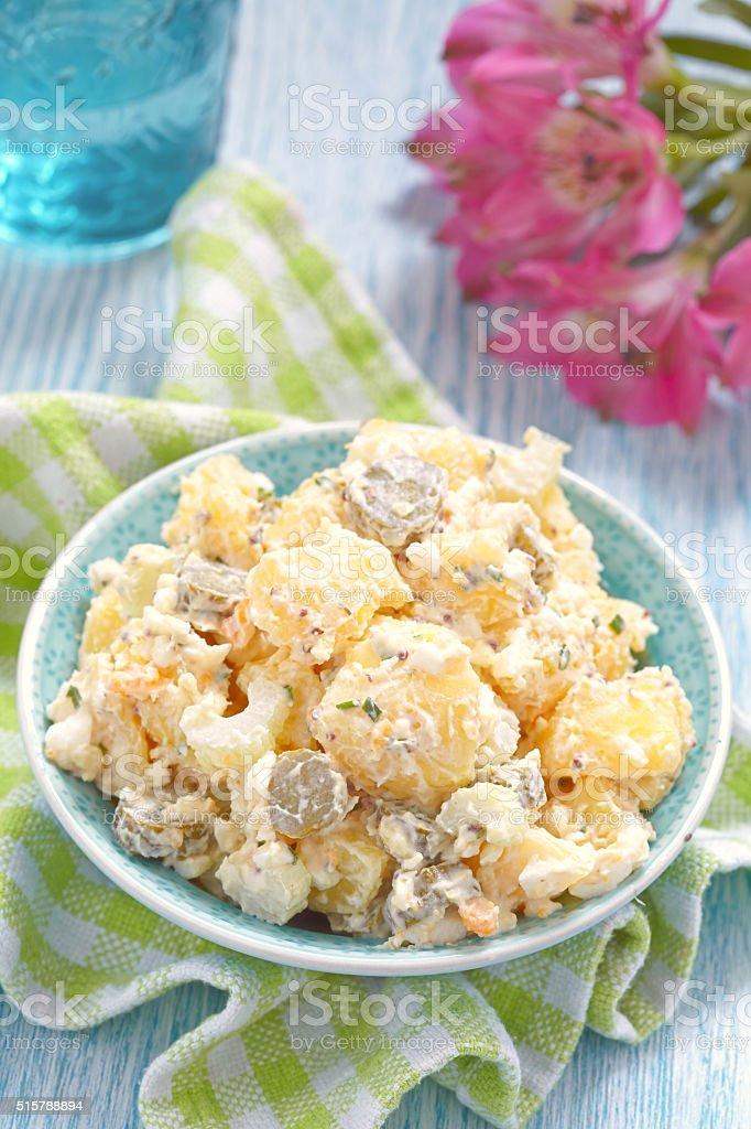 Potato salad with sour cream sauce stock photo