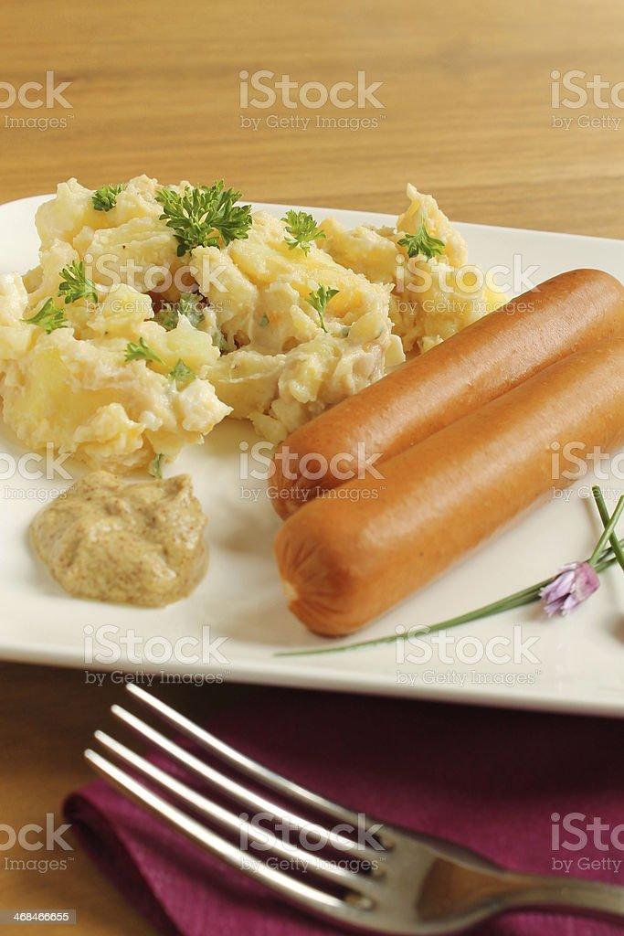 Potato salat with sausages stock photo