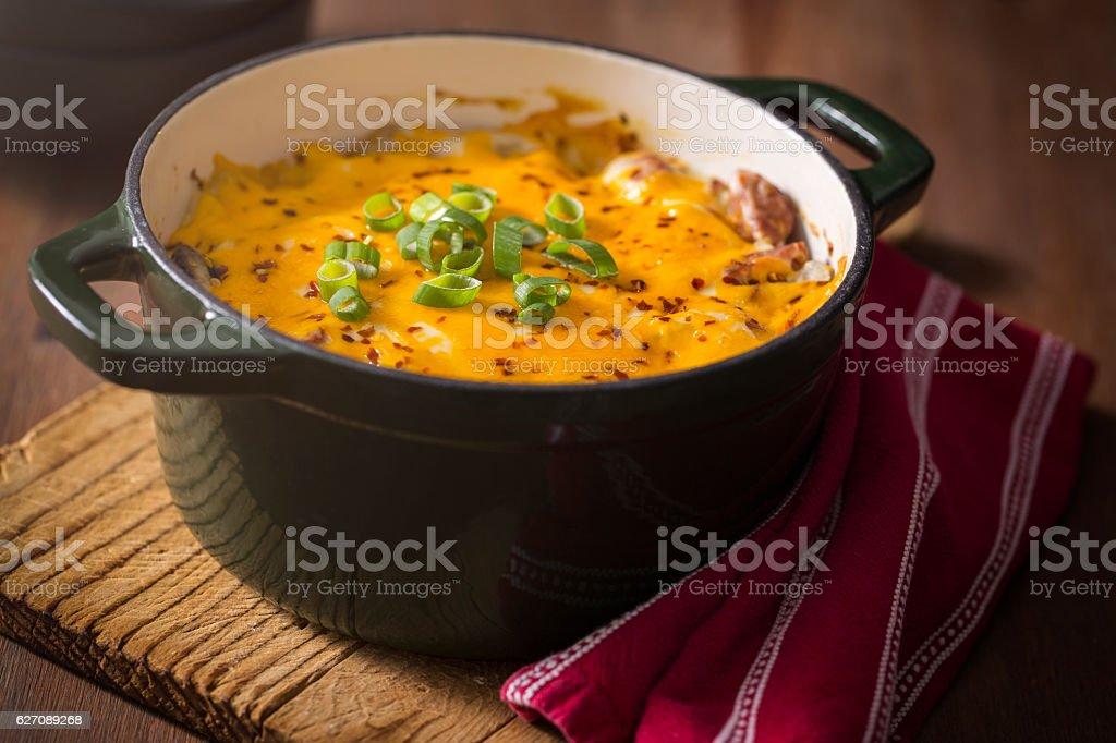 Potato Sausage Cheese Casserole in Cast Iron stock photo