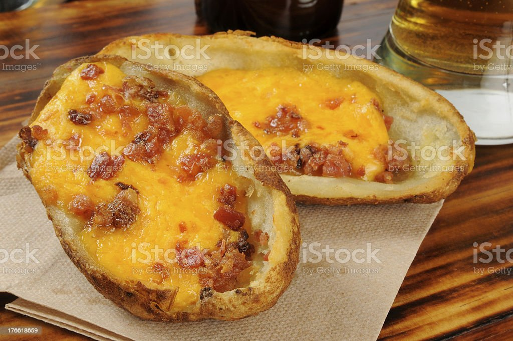 Potato skins and beer royalty-free stock photo