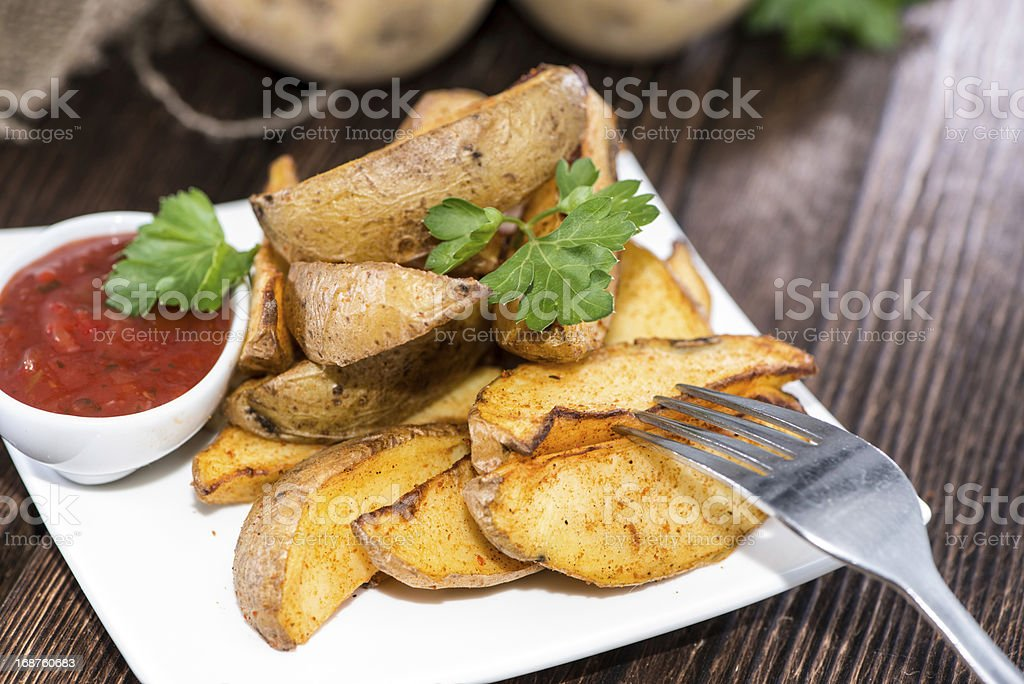 Potato Wedges with Parsley and Sauce stock photo