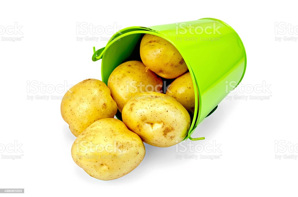 Potato yellow pours from green bucket royalty-free stock photo