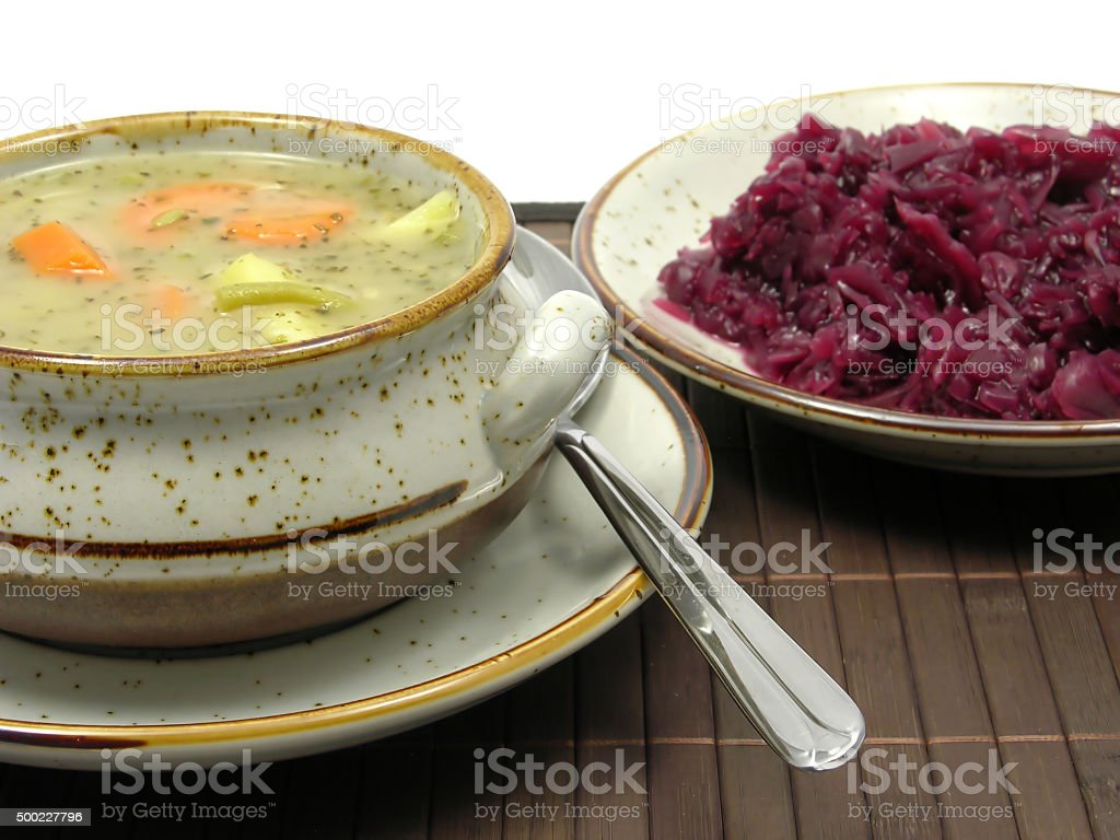 Potatoe stew and cooked red cabbage on a placemat stock photo