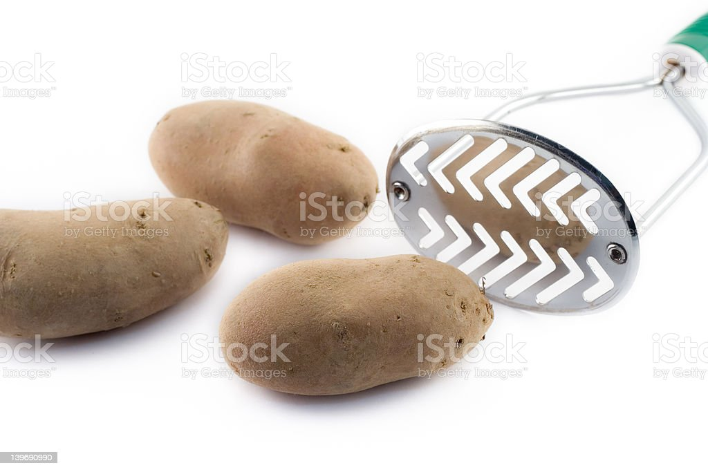 Potatoes and masher royalty-free stock photo