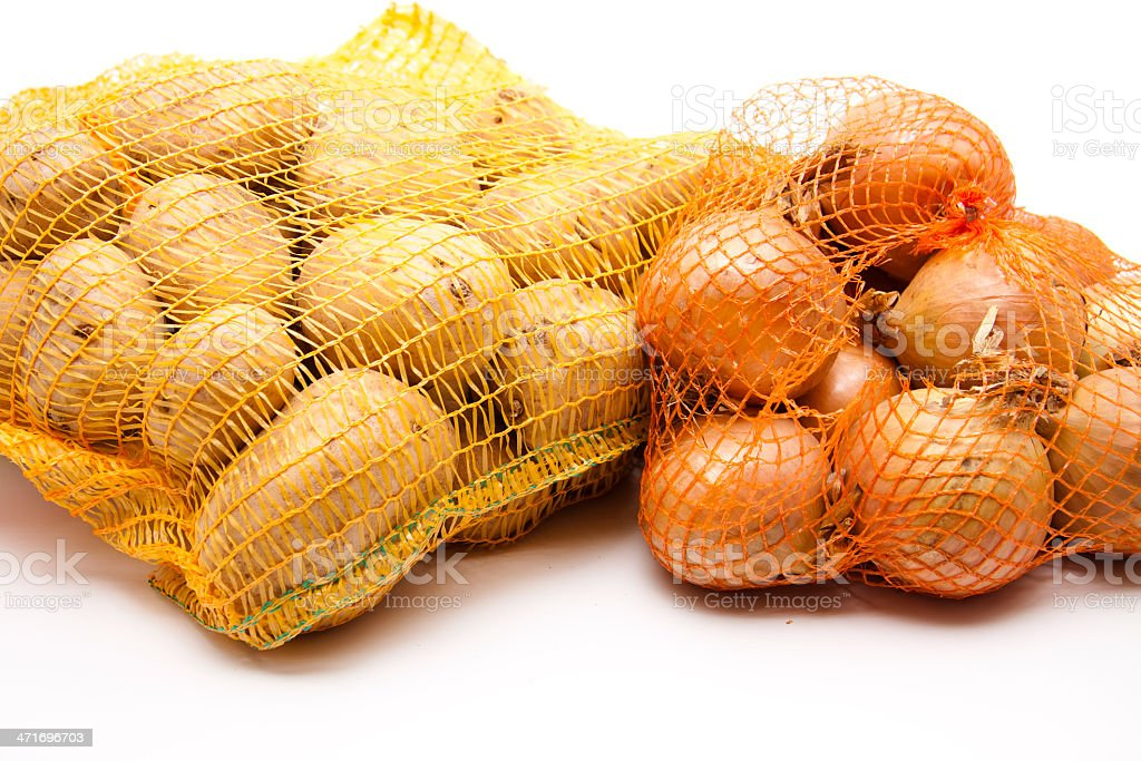 Potatoes and onions in the net royalty-free stock photo