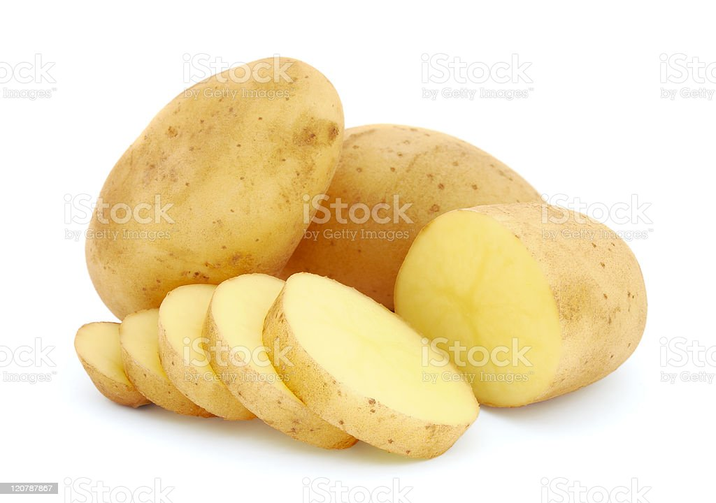 Potatoes and sliced potatoes on a white background stock photo