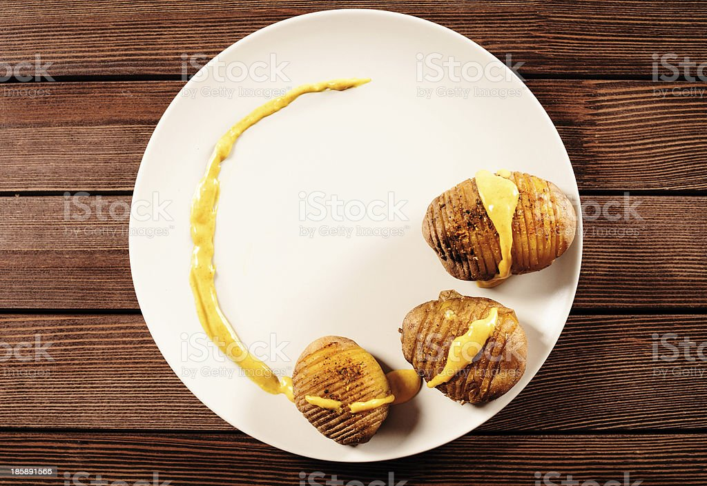 potatoes are served on dish with basil sauce and fennel royalty-free stock photo
