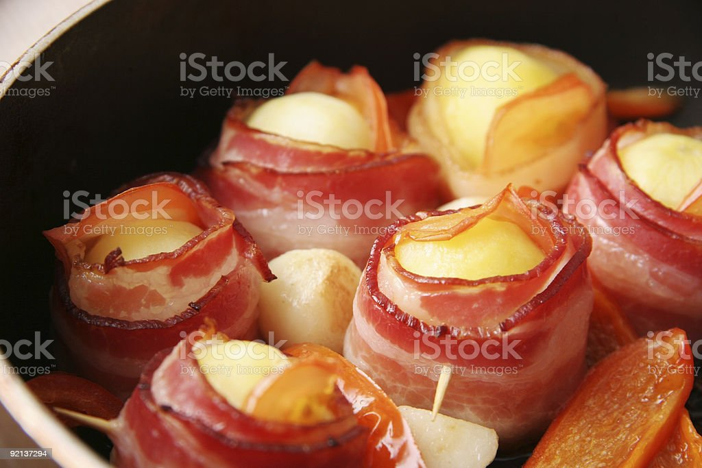 Potatoes baked in bacon. royalty-free stock photo