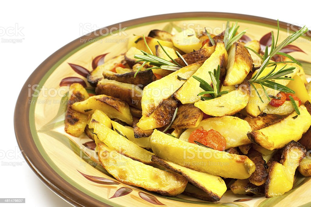 Potatoes baked in  oven with spices and rosemary stock photo