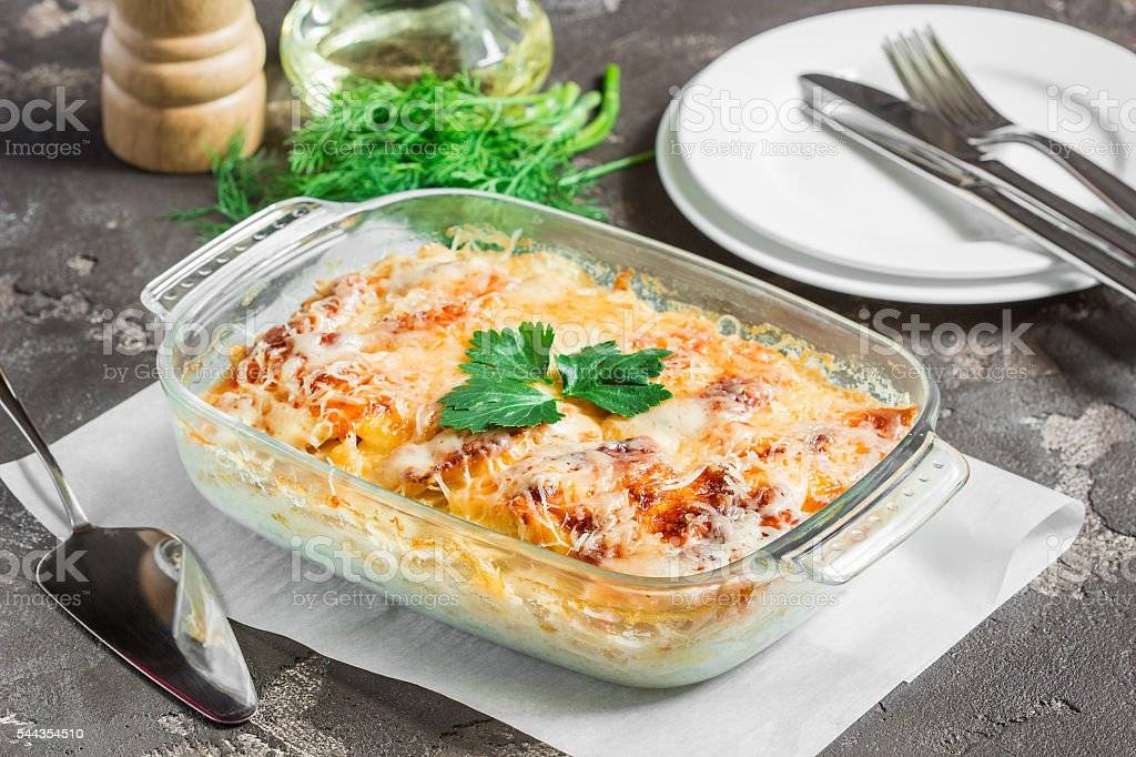 Potatoes cooked in the oven, baked with apples, cheese stock photo