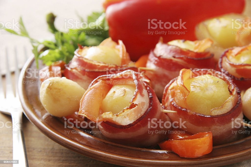 Potatoes in becon. royalty-free stock photo