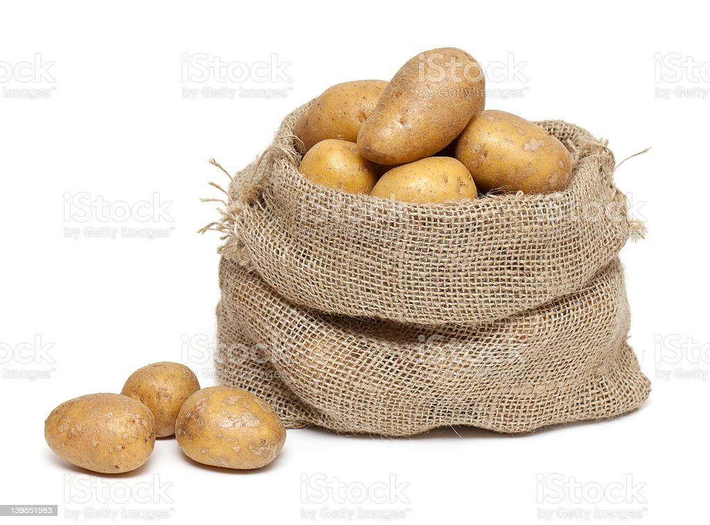 potatoes in burlap bag isolated on white stock photo