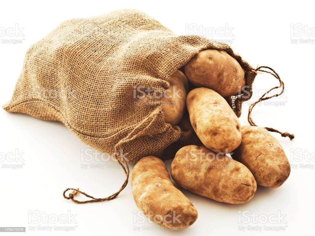potatoes in burlap stock photo