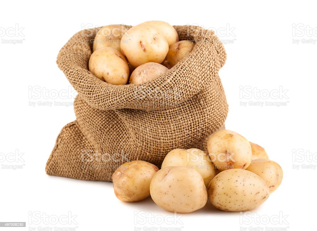 Potatoes in sack stock photo