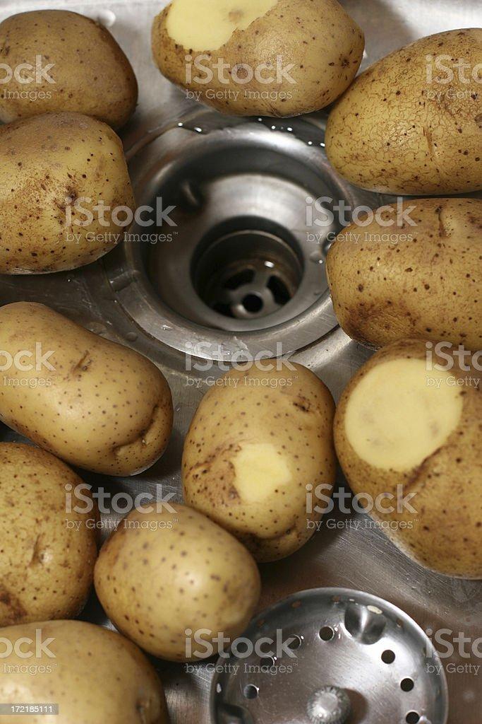 Potatoes in sink stock photo