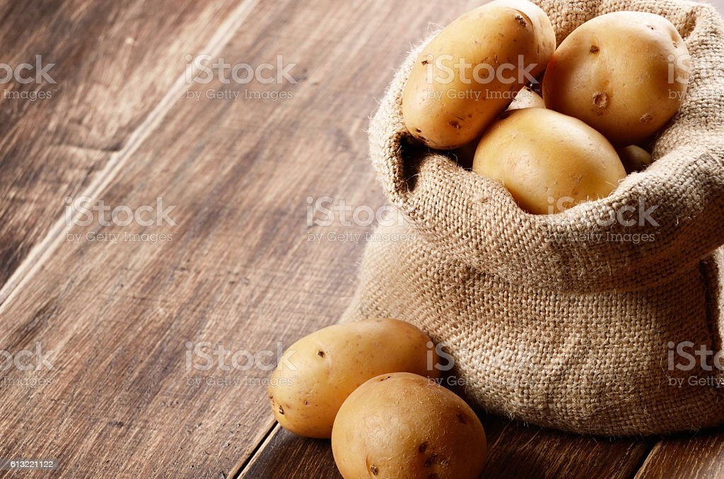 Potatoes in the sack stock photo