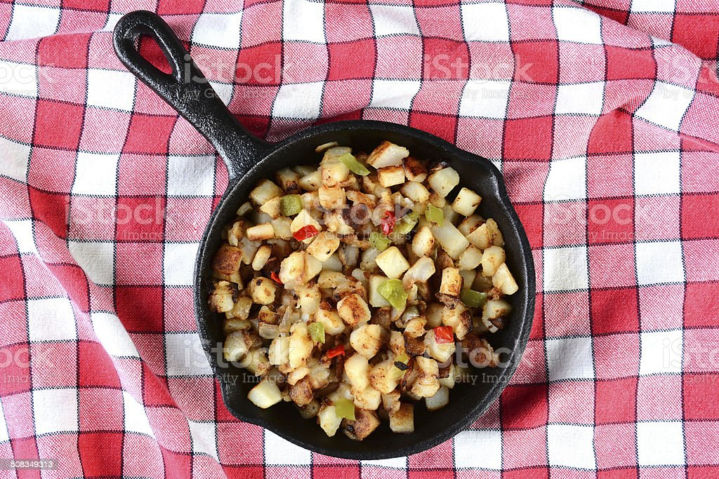Potatoes Obrien in Skillet on Red Checked Table Cloth stock photo