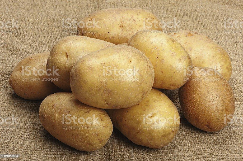 Potatoes on a sacking royalty-free stock photo