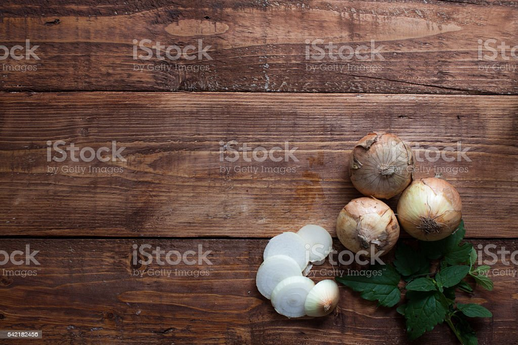 Potatoes on wooden background,sliced potatoes stock photo