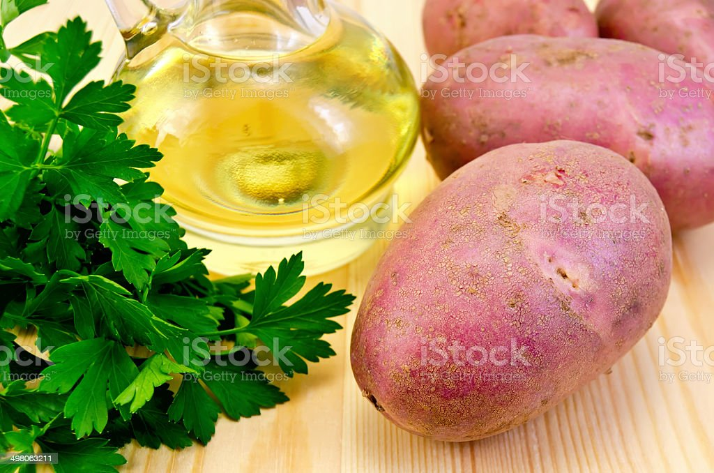 Potatoes red with parsley and oil stock photo