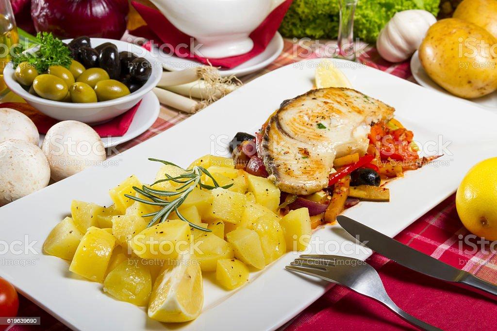 Potatoes Side Dish and Fried Fish Steak stock photo
