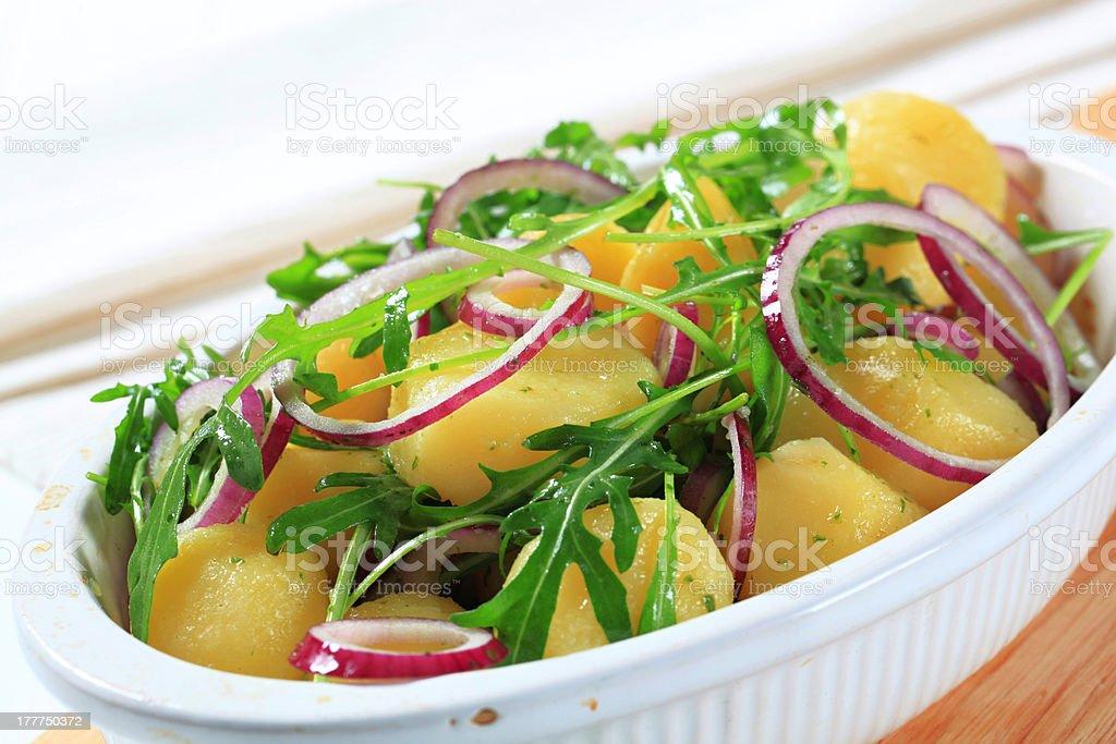 Potatoes with arugula and onion royalty-free stock photo