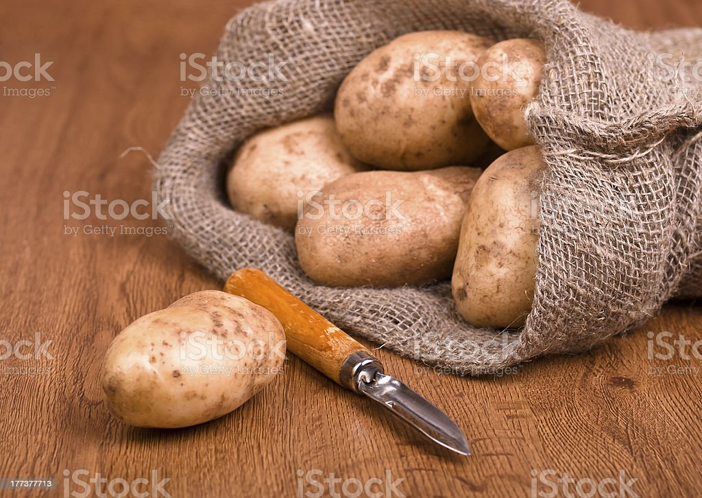 potatoes with knife to clean the vegetables royalty-free stock photo