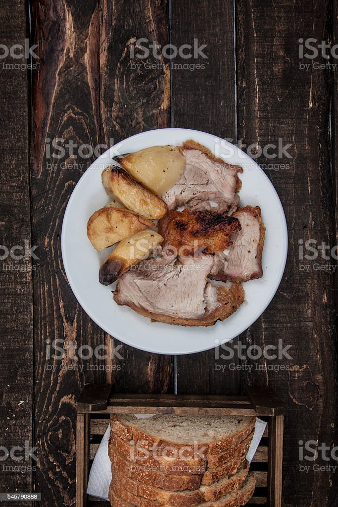 Potatoes with meat in the oven stock photo
