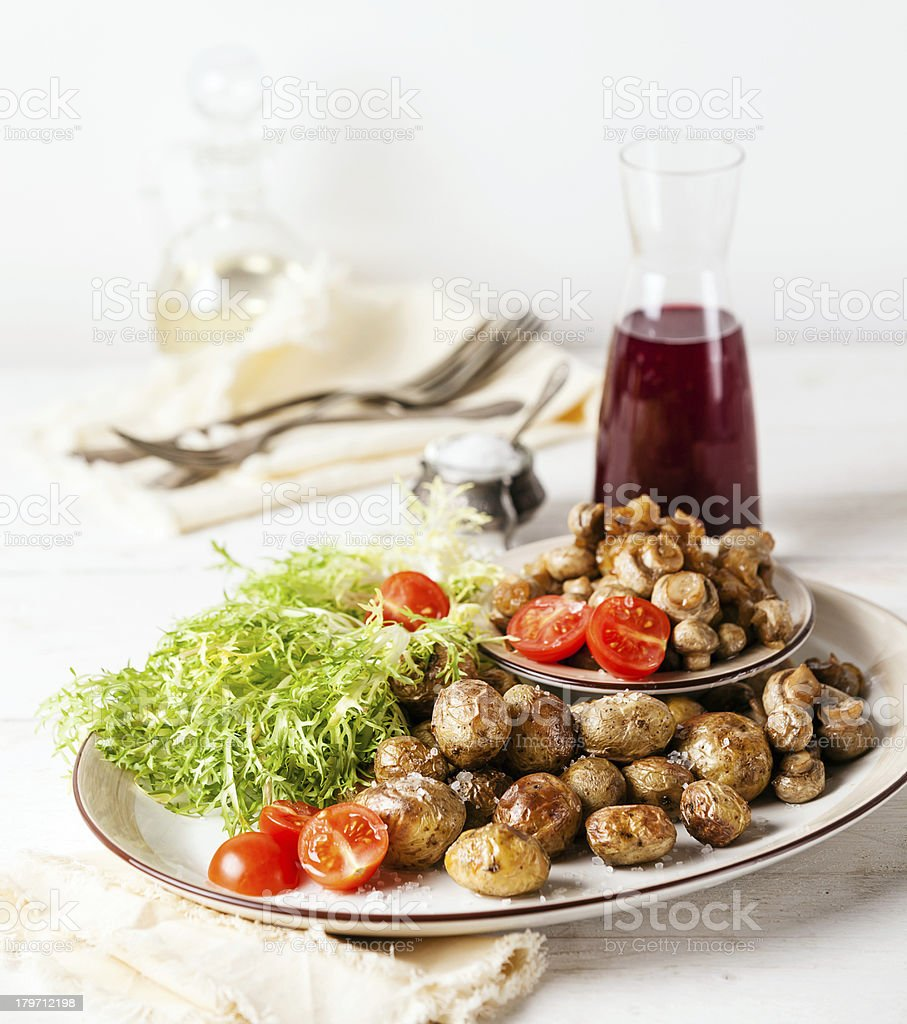 potatoes with mushrooms stock photo