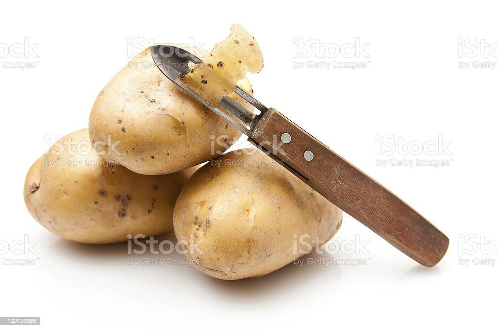 Potatoes with potato peeler stock photo