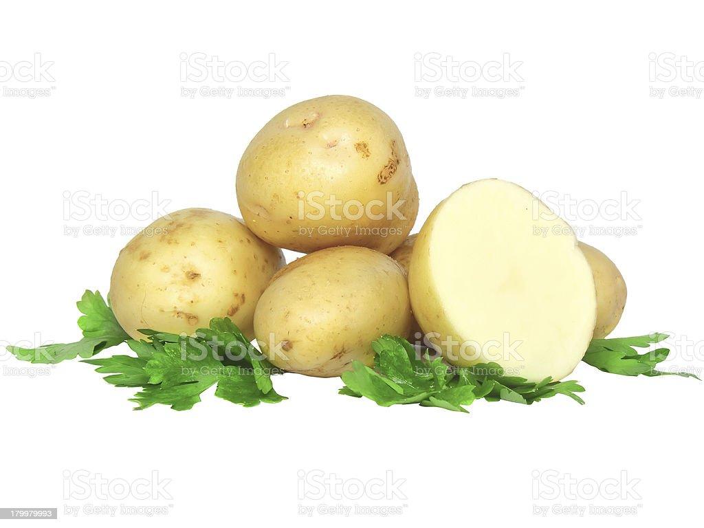 Potatos  and parsley . Isolated stock photo
