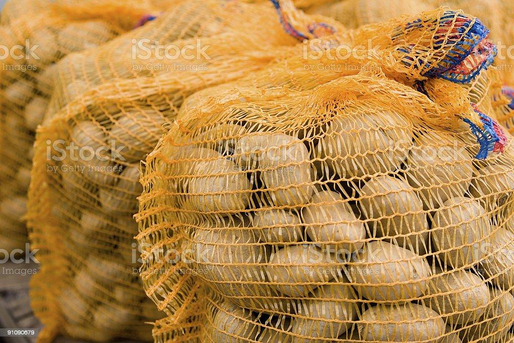 Potatos in sacks at a market stock photo