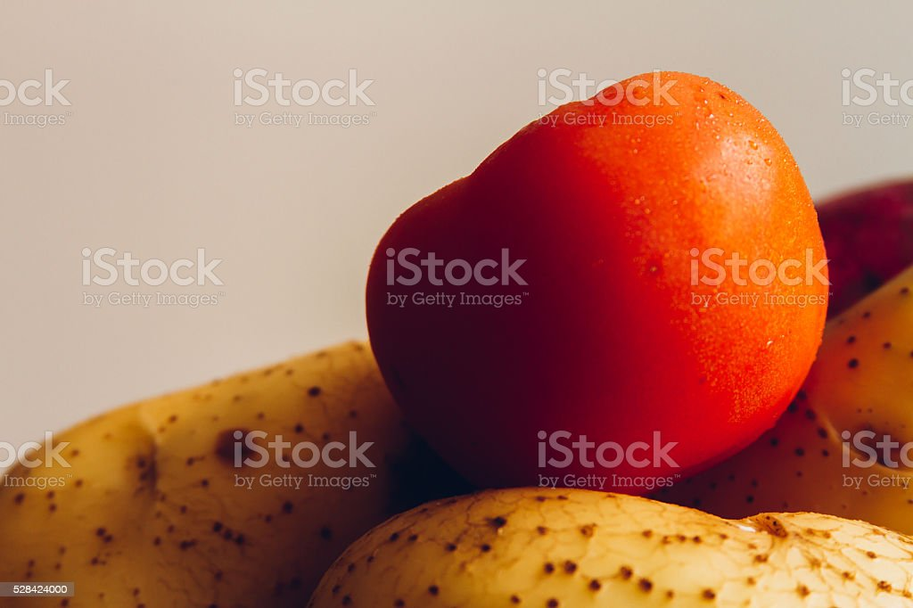 Potatos, yams and tomato stock photo