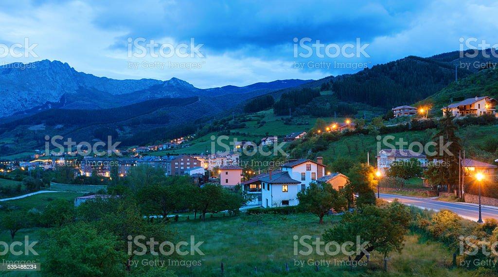 Potes at dusk,  Cantabria, Spain. stock photo