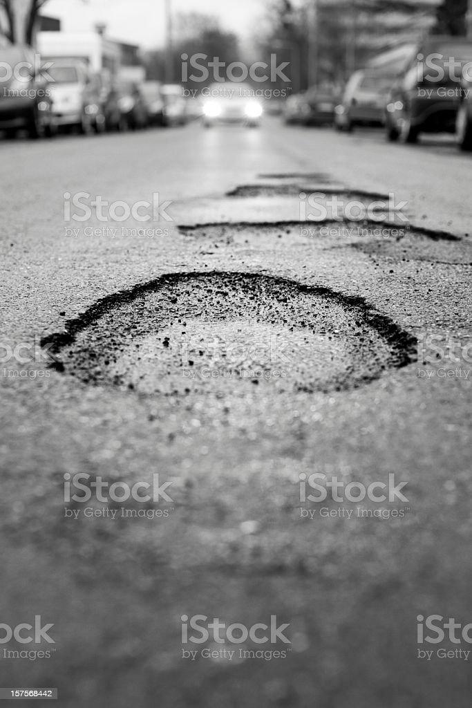 Pothole, black and white - selective focus royalty-free stock photo