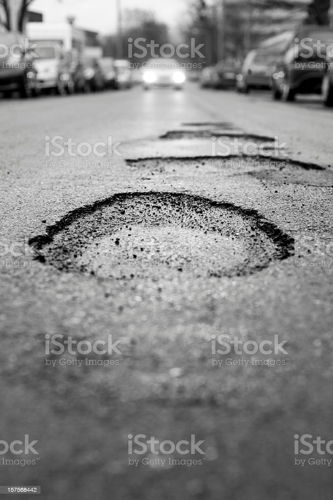 Pothole, black and white - selective focus stock photo