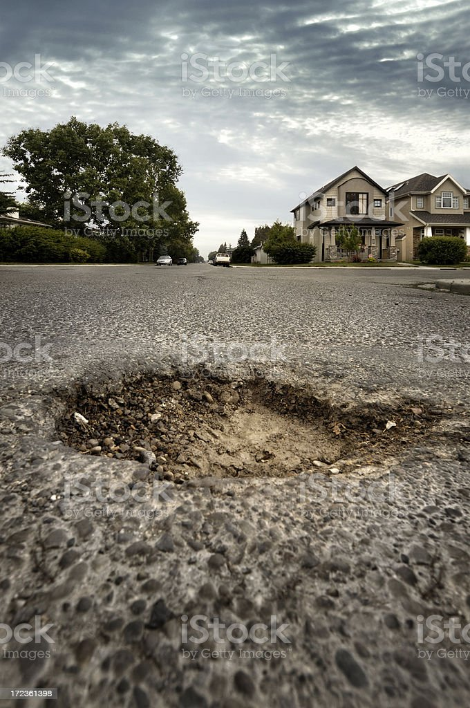 Pothole in Residential Neighbourhood royalty-free stock photo