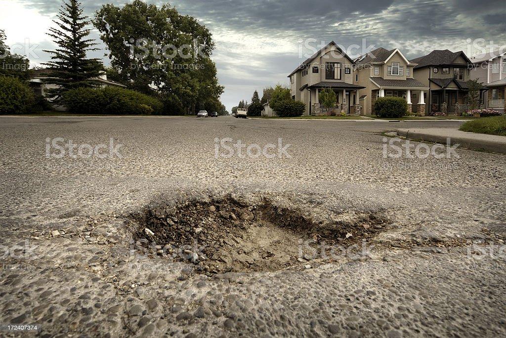 Pothole in Residential Neighbourhood stock photo