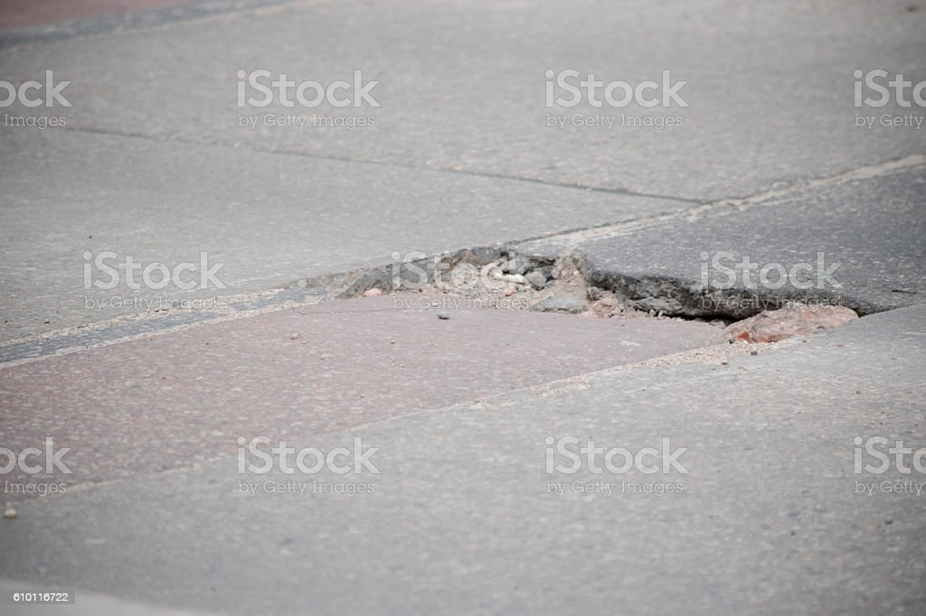 pothole in road stock photo