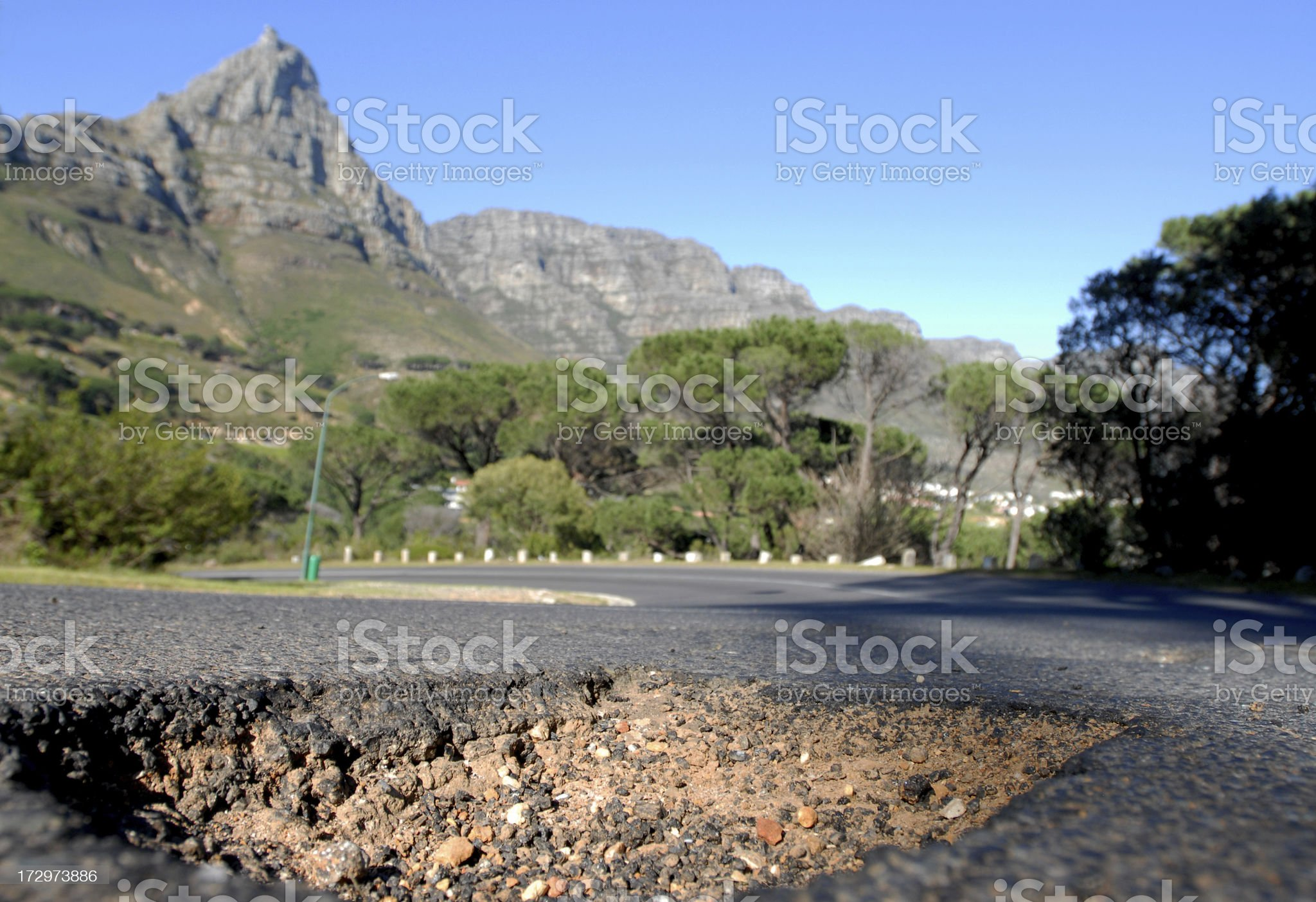 Pothole on a road royalty-free stock photo