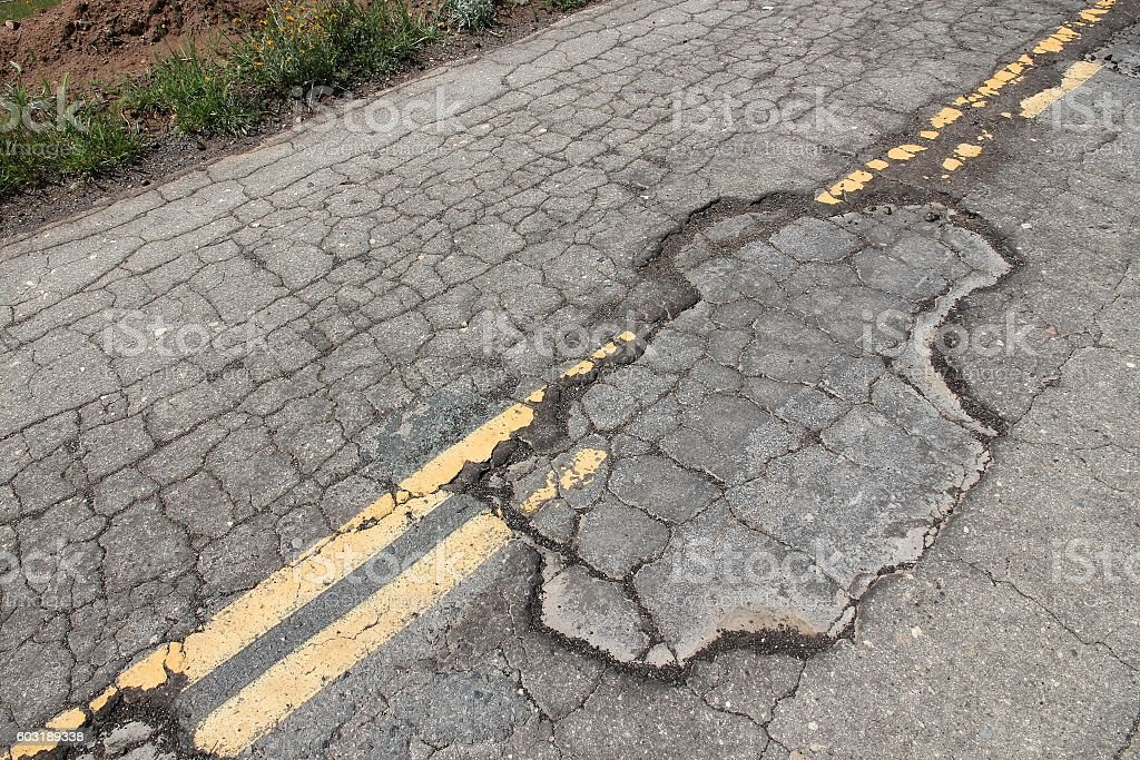 Pothole road stock photo