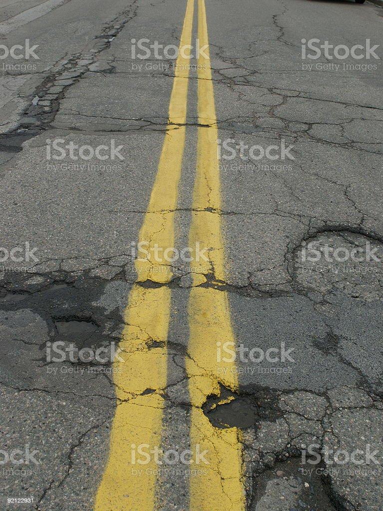 Potholes on a double line stock photo