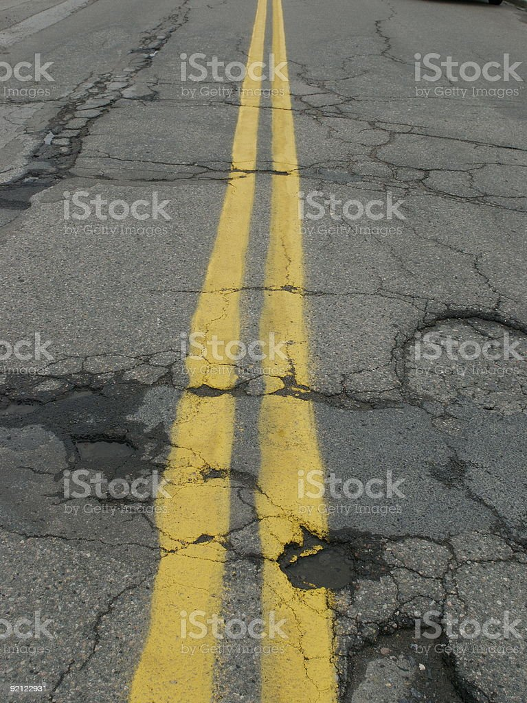 Potholes on a double line stock photo