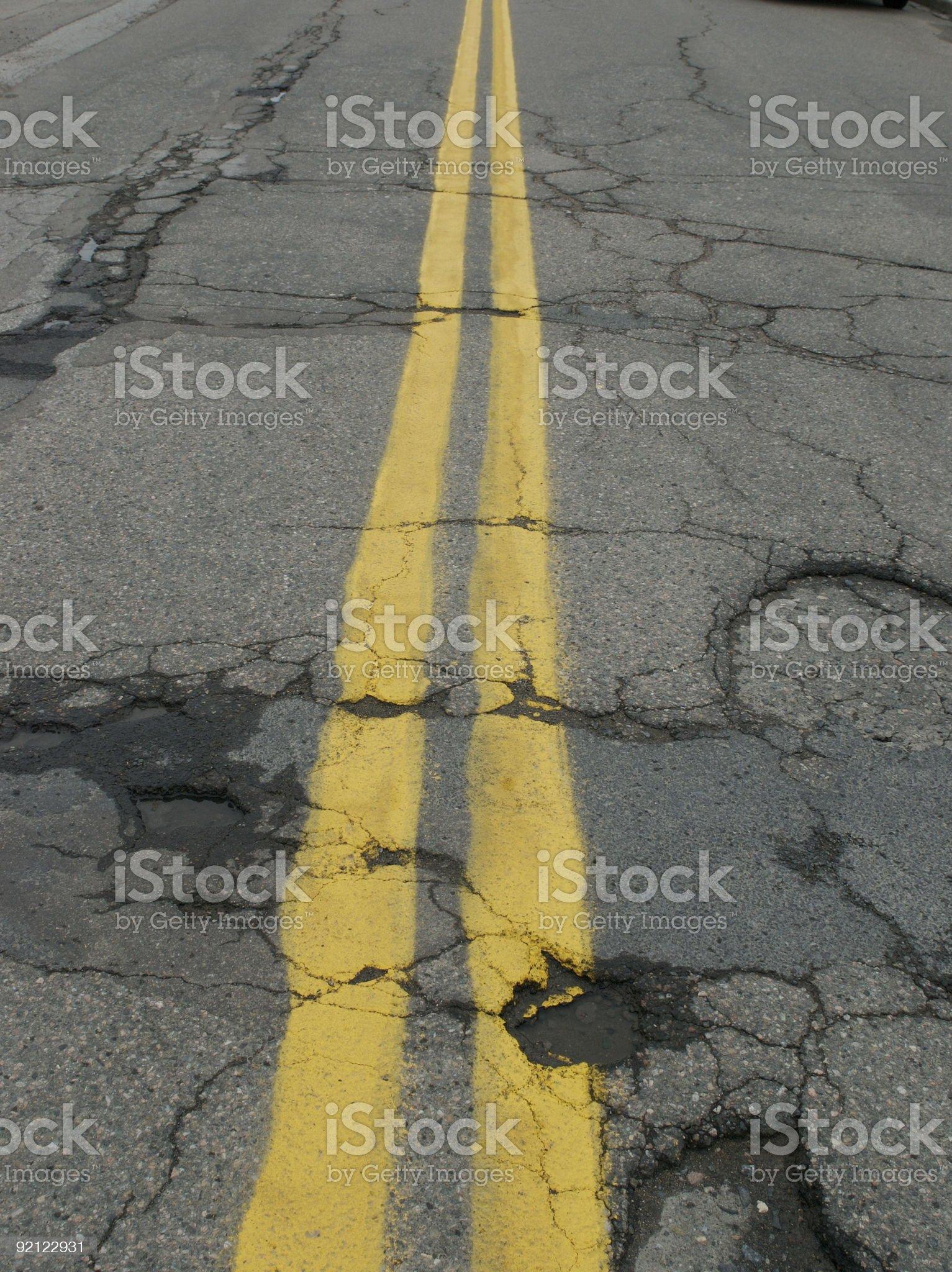 Potholes on a double line royalty-free stock photo