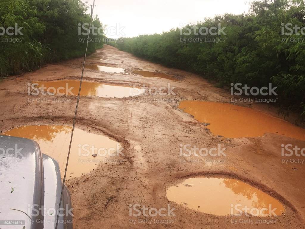 Potholes on back country road, Kauai, Hawaii stock photo