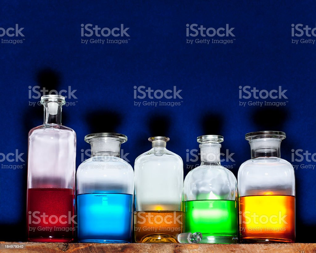 Potions Bottles on a Blue Background. stock photo