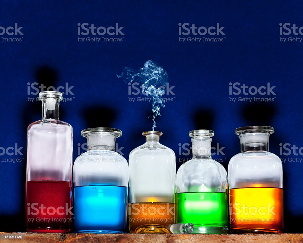 Potions Bottles with cloud, Blue Background. stock photo