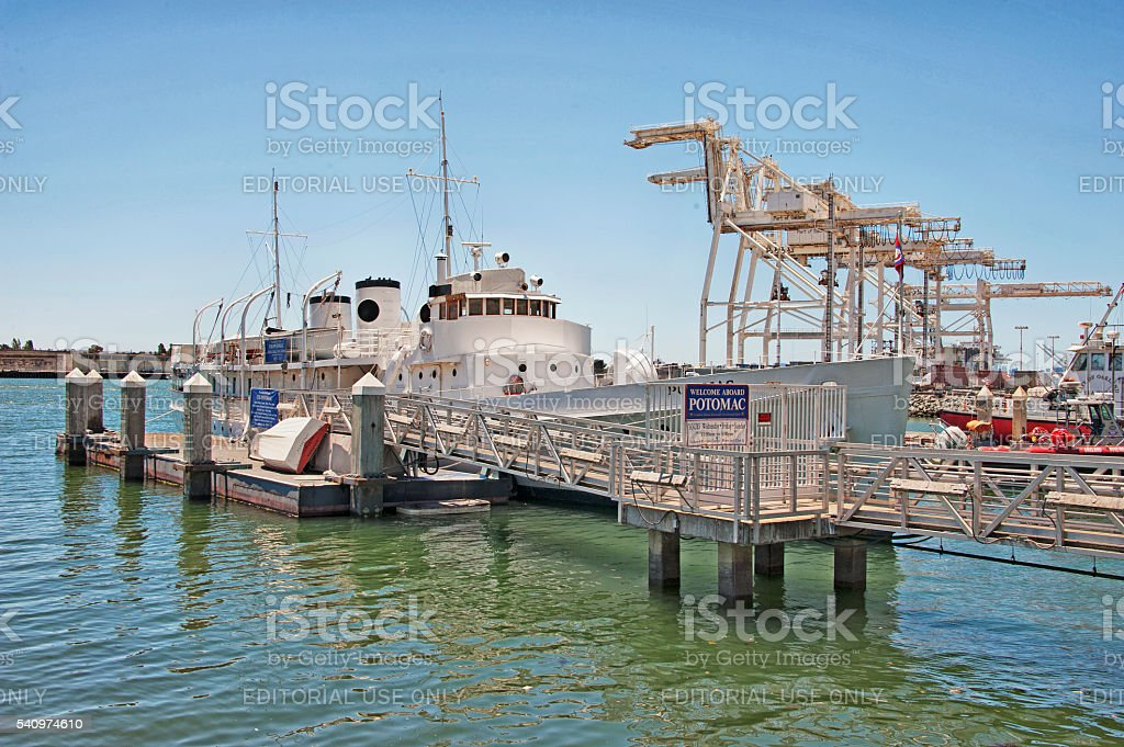 USS Potomac and Pier by Port of Oakland Shipyard stock photo