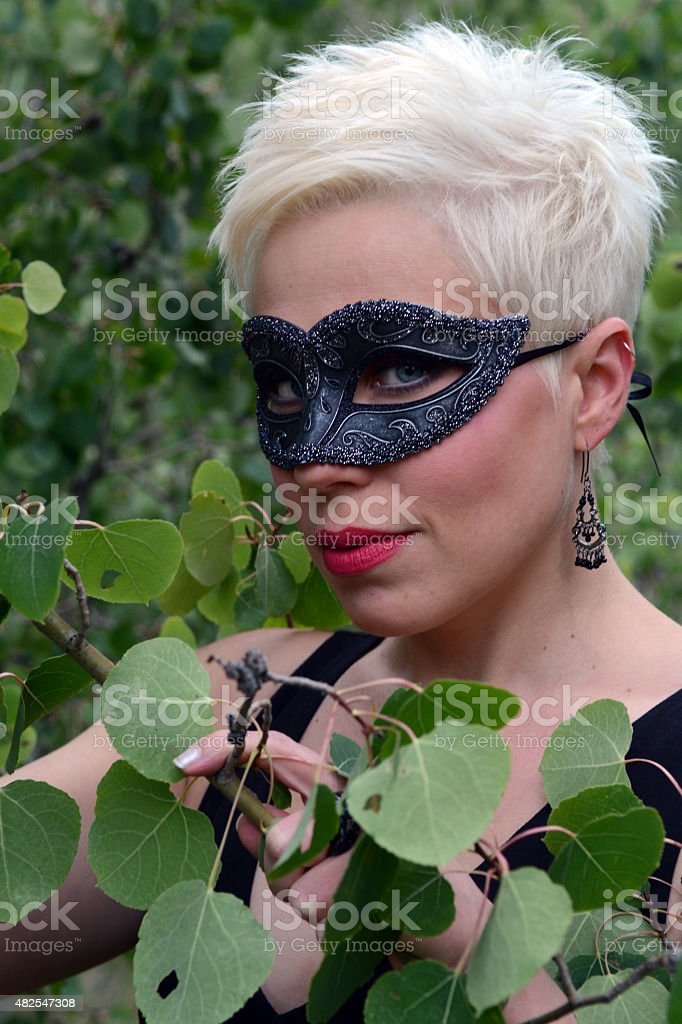 Potrait of a Woman Wearing a Black Mask royalty-free stock photo